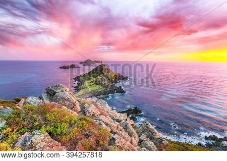 Sunset Over Popular Tourist Destination Torra Di A Parata With Genoese Tower And Archipelago Of Sang