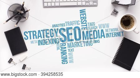 Search Engine Optimization Wordcloud With Words Seo And Internet Terms Over White Office Table Stati