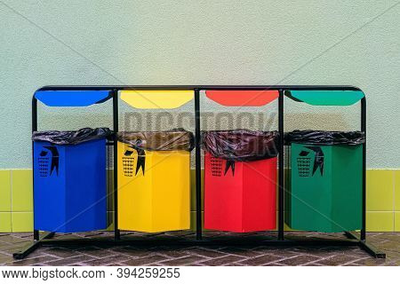 Separate Collection Of Glass, Metal, Paper And Plastic. Colored Bins For Separate Garbage.