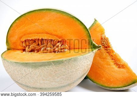 Ripe Delicious Melon And A Piece Of Melon Are Isolated On A White Background. Cantaloupe Melon.
