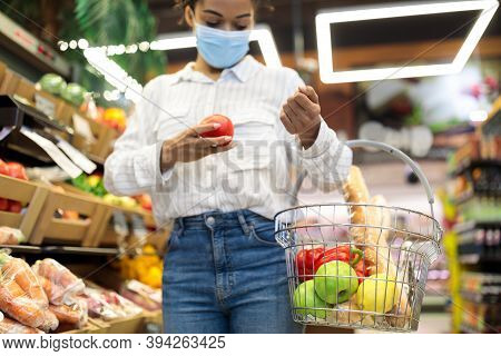 African American Woman Doing Grocery Shopping Buying Fresh Vegetables In Supermarket, Walking With B
