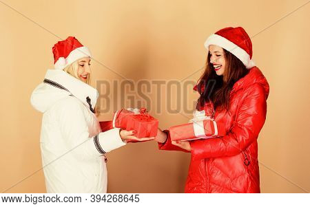 Christmas Mood. Winter Clothes. Girls Wear Winter Jackets Beige Background. Buy Gifts. Shopping Day.