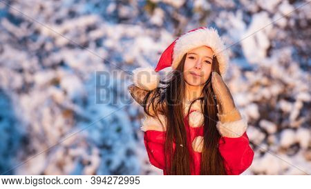 Frosty Christmas Morning. Santa Claus. Sunny Winter Day. Child Happy Girl Outdoors Snowy Nature. Mer