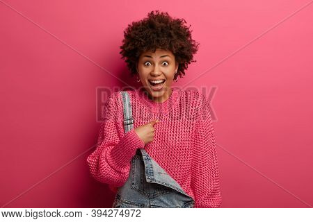 Surprised Cheerful Curly Woman Herad Her Name, Points At Herself, Being Chosen Or Selected By Someon
