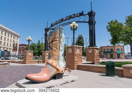 Cheyenne, Wy - August 8, 2020: Large Cowboy Boot Art Sculpture Outside In The Historic Cheyenne Depo