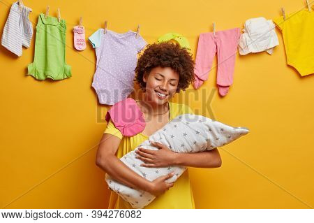 Happy Caring Mother And Her Baby Embraces Tenderly Infant Wrapped In Blanket With Great Love, Nursin
