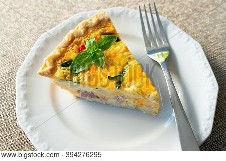 Fresh Slice Of Quiche Lorraine On A White Plate
