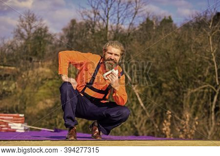 Fix Or Build. Roofer Repair Roof. Roof Installation. Bearded Man Work Outdoor. Roof Mechanic Concept