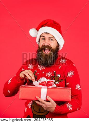 Lets Open It. Merry Christmas And Happy New Year. Brutal Bearded Santa Male Red Background. Excited
