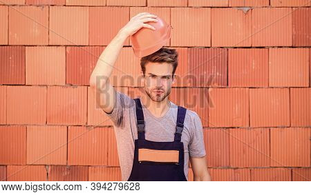 Worker Brick Wall Background. Building Construction. General Maintenance Repair Worker Fix Maintain