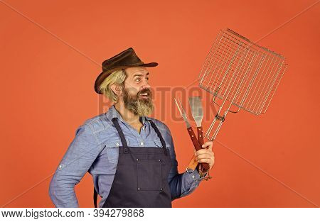 American Picnic. Bearded Farmer Wear Hat And Apron For Barbecue. Roasting Meat. Steak And Barbecue.