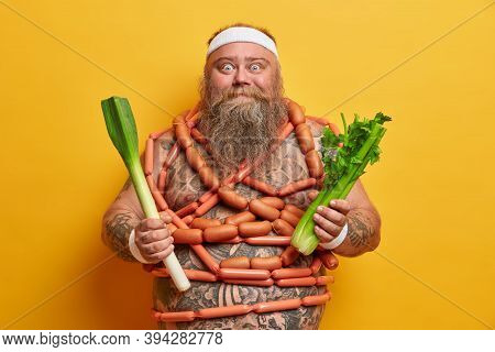 Positive Overweight Man With Thick Belly And Sausages Around, Obsessed With Food, Keeps To Diet, Hol