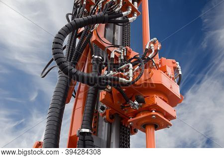 Oil Or Gas Drilling Rig, Close Up Of Part Of Drive System For Oil And Natural Gas Industry Over Blue