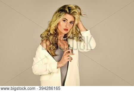 Female Fragrance Concept. Perfume Created For Daring Person. Girl Long Curly Hair Satisfied With Aro