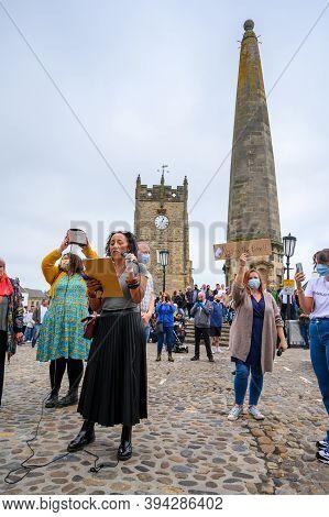 Richmond, North Yorkshire, Uk - June 14, 2020: Female Blm Protester Leading Black Lives Matter Prote