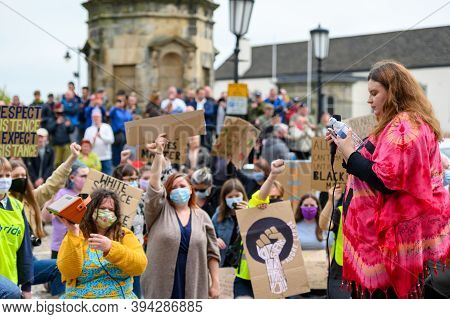 Richmond, North Yorkshire, Uk - June 14, 2020: Blm Protesters Wearing Ppe Face Masks Salute And Hold