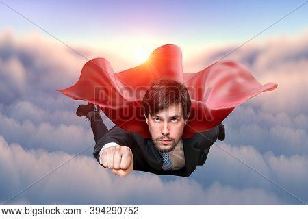 Brave Businessman In Suit Is Flying In Sky As Superhero.