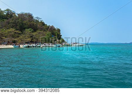 Koh Talu, Rayong Thailand - Feb, 8, 2019: Close Up Of Tourists And Tourist Boats On The Famous Beach