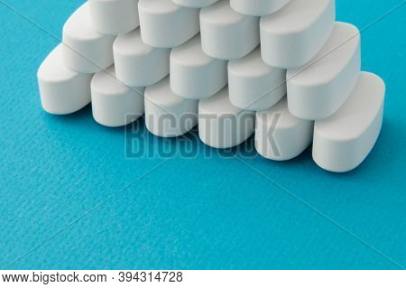 Pharmacological Health Care Many Medical Tablets On Blue Surface With Copyspace