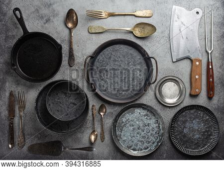 Old Vintage Tableware And Kitchen Utensils On Rustic Stone Background, Top View. Various Metallic Pl