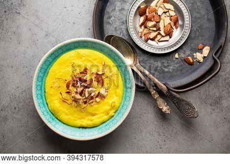 Traditional Indian Dish Kheer, Sweet Rice Milk Pudding With Almonds And Saffron In Blue Ceramic Bowl