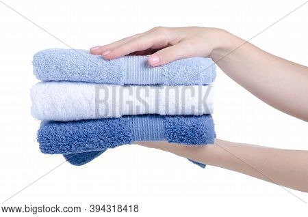 Stack Folded Towels In Hand On White Background Isolation