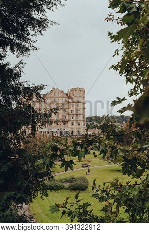 Bath, Uk - October 04, 2020:view Through The Trees Of Parade Gardens And Buildings On Grand Parade I