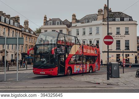 Bath, Uk - October 04, 2020: Open Top  Tour Bus On A Street In Bath, The Largest City In The County