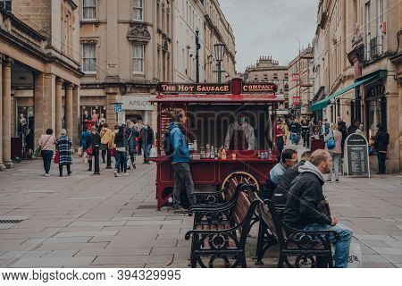 Bath, Uk - October 04, 2020: Staff In Face Mask At Hot Sausage Food Cart On A Street In Bath, The La