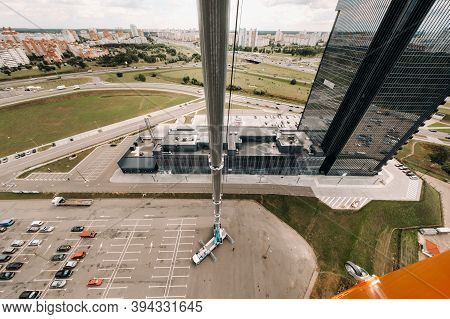 View From The Height Of The Tallest Car Crane, Which Is Open In The Parking Lot Near The Glass Build