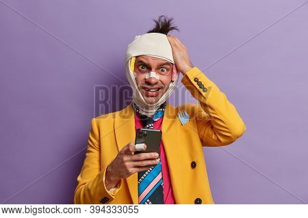 Frustrated Puzzled Man Takes Revenge From Someone, Keeps Hand On Head, Gets Strange Message On Cellu