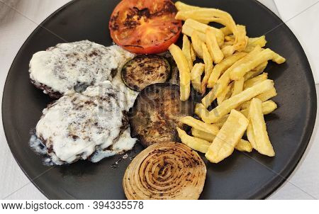 Venison Burgers With Cabrales Sauce, Fried Potatoes And Grilled Tomato, Onion And Aubergine