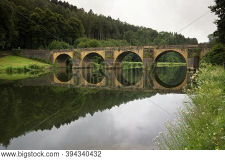 The Famous Nicholas Bridge Over The Semois River Near Chiny In The Belgian Ardennes