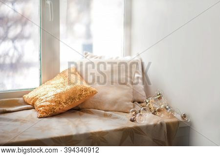 Window Sill And Pillows, Empty Space. Gold Pillow With Sequins, Window, Garland.