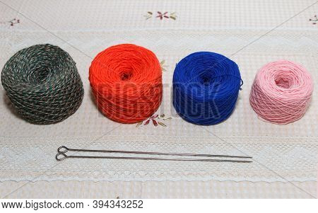Coils With Multy Color Yarns Are Prepared For Knitting Clothes On Spokes, Handmade