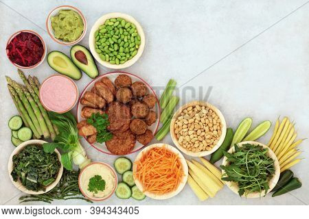Vegan food for a healthy lifestyle with plant based foods high in antioxidants, protein, minerals, fibre, anthocyanins, vitamins, omega 3 & carotenoids. Heath food concept. Flat lay with copy space.