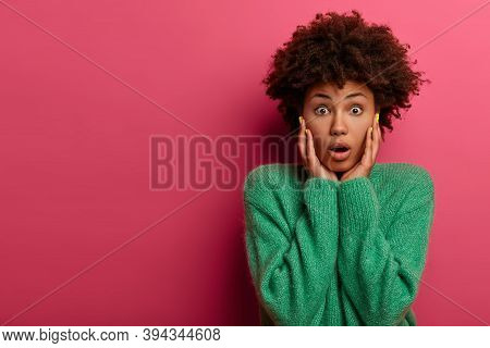 Photo Of Shocked Stunned Afro American Woman Hears Fresh Rumor, Has Eyes Popped Out, Opens Mouth Fro