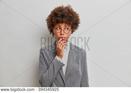 Frustrated Moody Adult Afro American Woman Entrepreneur Wears Round Spectacles Formal Suit, Expresse