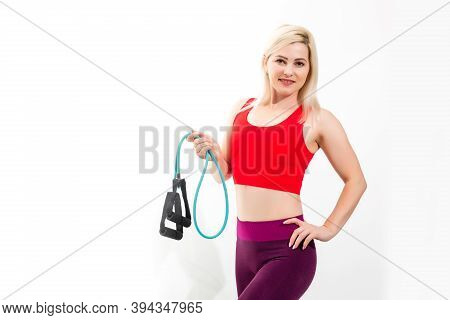 Close Up Portrait Of A Confident Young Fitness Woman Doing Exercises With Hand Expander Isolated Ove