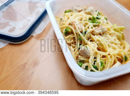 Takeaway Food In Plastic Box. Spaghetti With Broccoli, Chicken Meat And Parmesan.