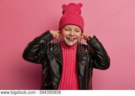 Joyful Little Preschooler Covers Ears, Keeps Index Fingers In Ear Holes, Avoids Hearing Loud Music,