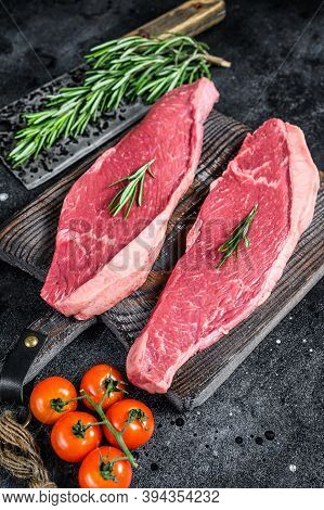 Raw Top Sirloin Cap Or Picanha Steak. Black Background. Top View