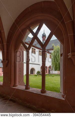 View Through A Window Into The Inner Garden Of The Eberbach Monastery