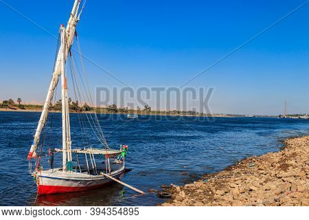 Felucca Boat Moored Near The Shore Of Nile River In Luxor, Egypt