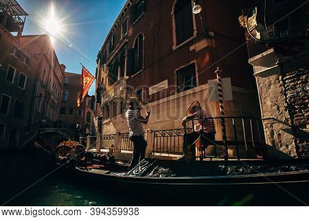 28 September 2018. Italy. Venice. At 16:52 Pm. Two Gondoliers On A Gondola.