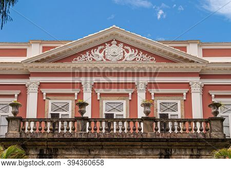 Petropolis, Brazil - December 23, 2008: Imperial Emblem In White Fresco On Pink Facade With White Fr