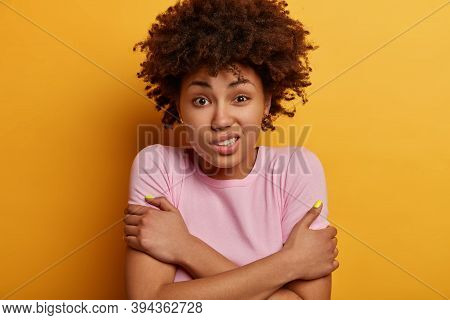 Headshot Of African American Woman Crosses Arms Over Body, Clenches Teeth, Trembles From Cold, Low T