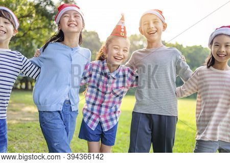 Group Of Happy Kids Having Fun In Christmas Party
