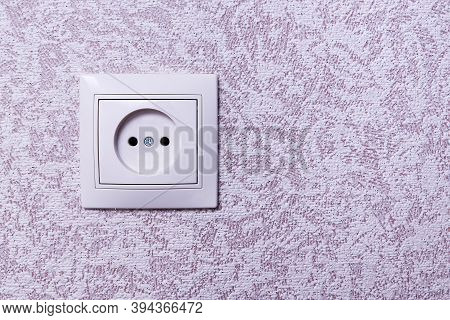Close Up Photo Of A White 220 Volt Power Socket On The Wall With Copy Space. 220 Volt European Outle