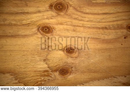 Plywood. A sheet of plywood with knots and wood grain. Plywood is used world wide in many construction projects.